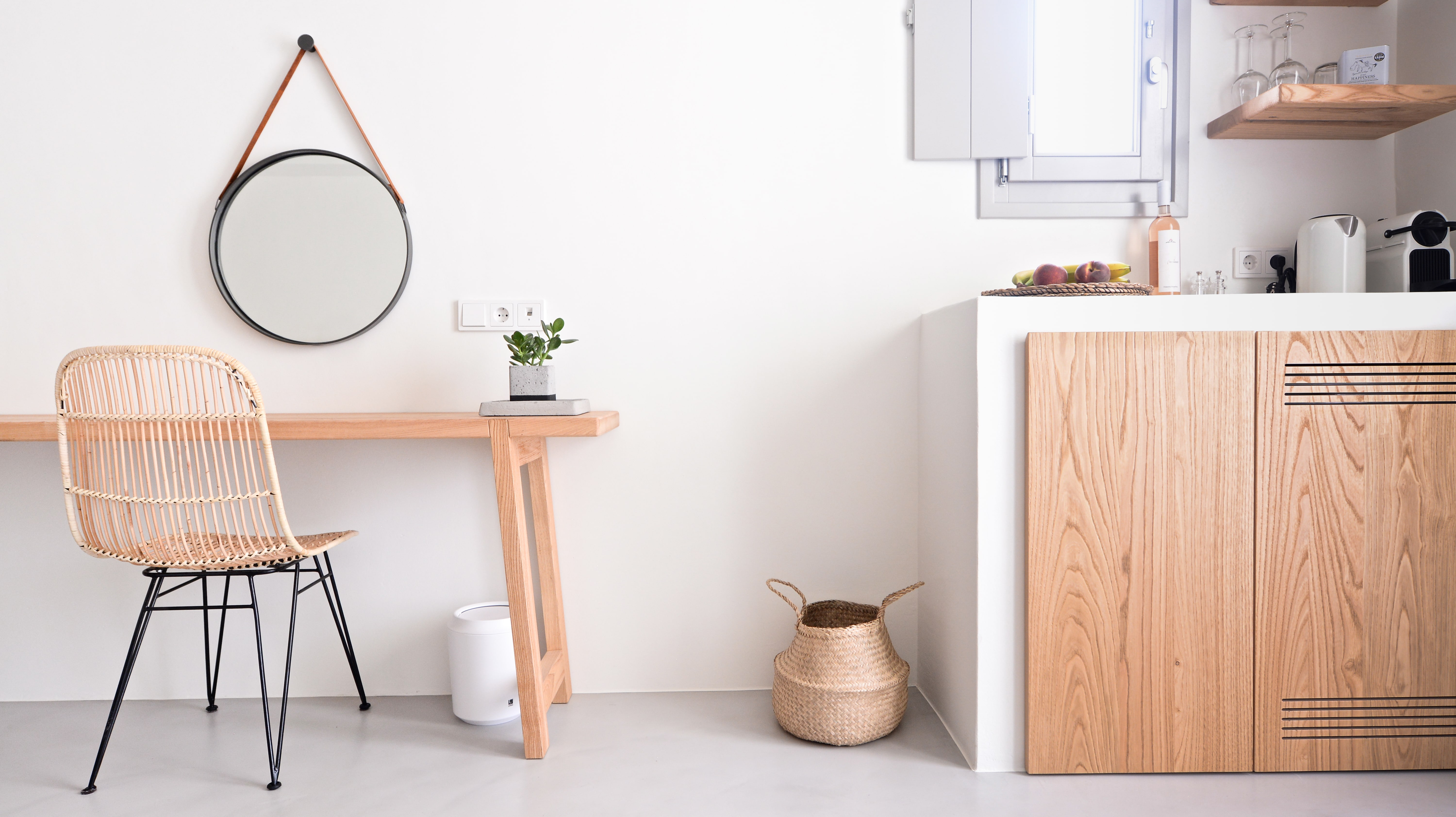 small stylish hotel desk and kitchenette detail