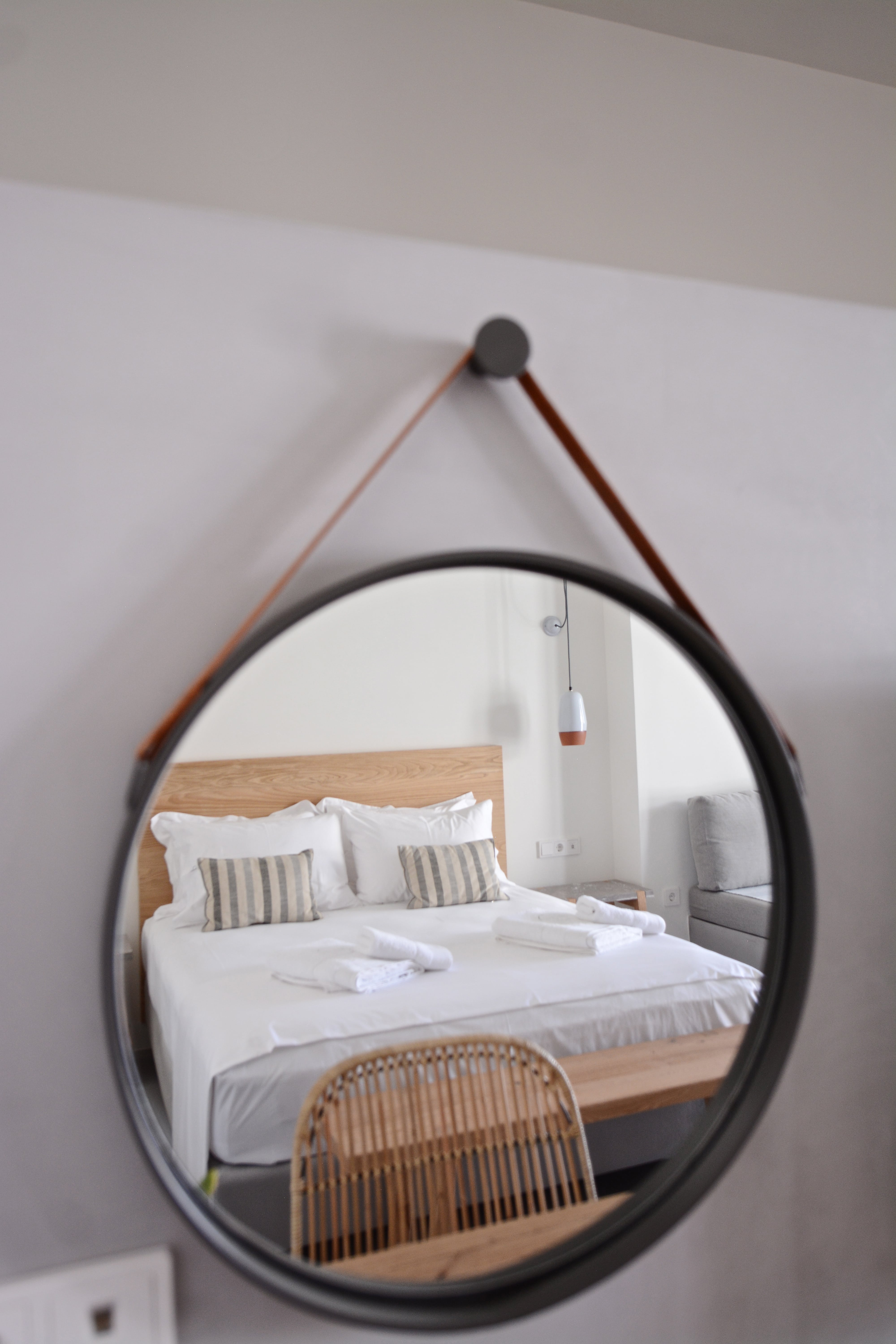 Serifos boutique hotel Suite 3 bethroom detail in round mirrow