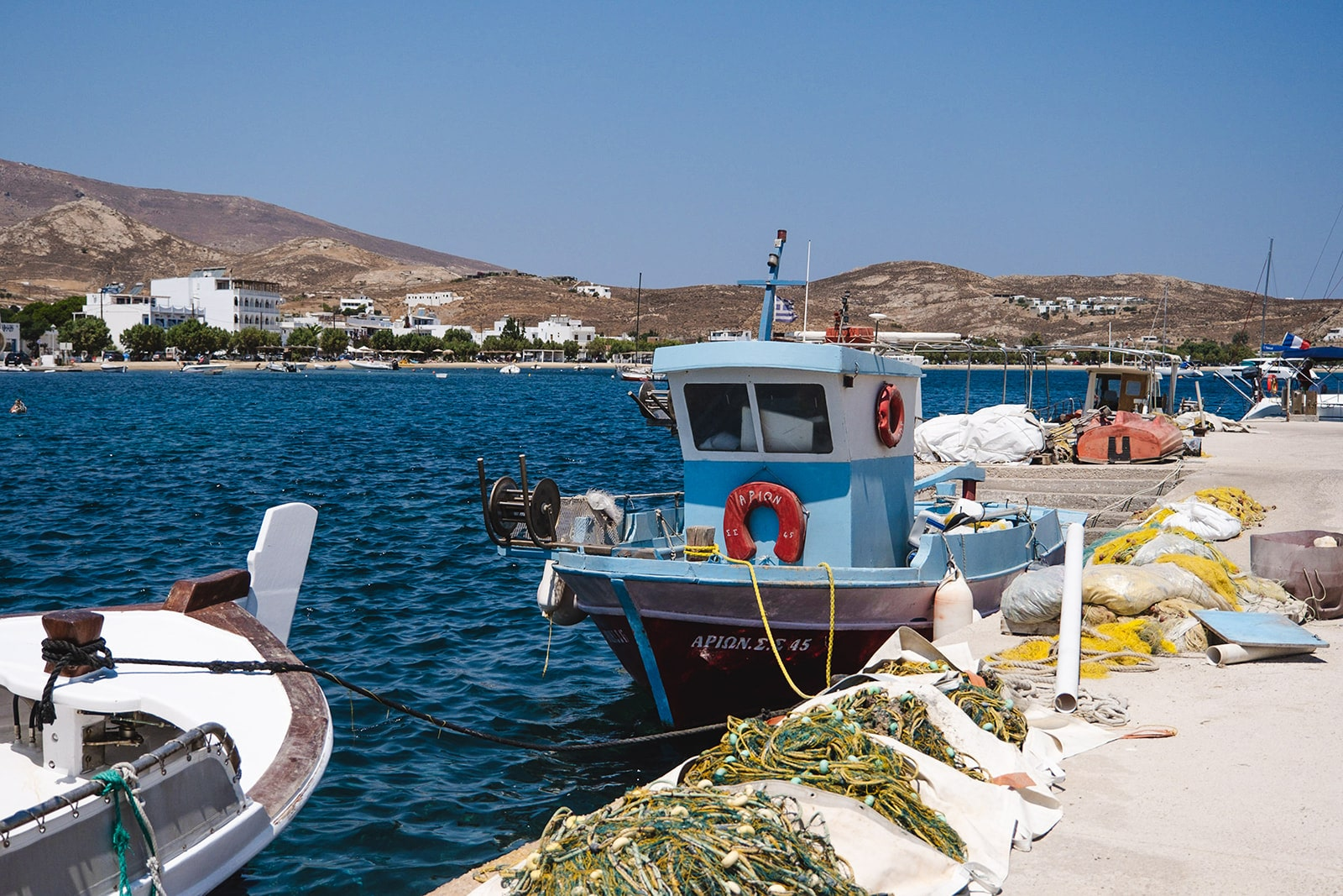 Traditional greek fisihing boat in the port of Serifos island