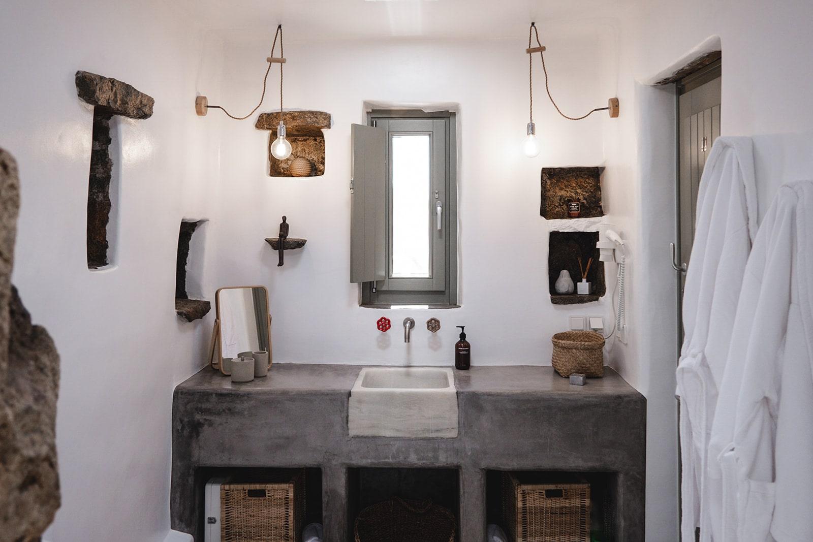 Keli Serifos bathroom with marble sink and Grown Alchemist toiletries